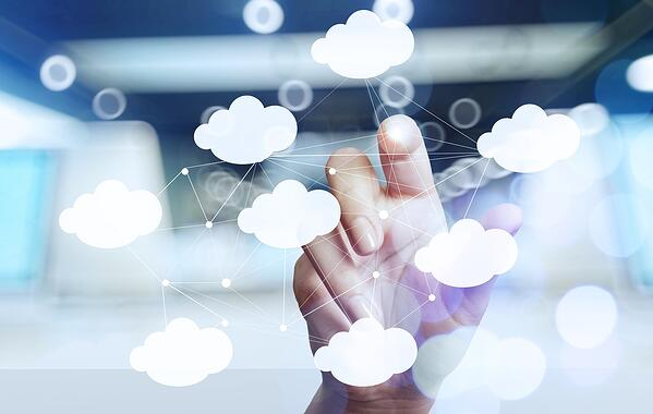 Woman's hand working with a Cloud Computing diagram