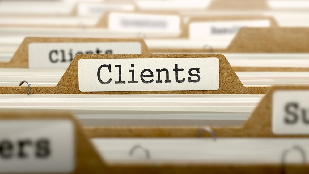 Clients Concept. Word on Folder Register of Card Index. Selective Focus.